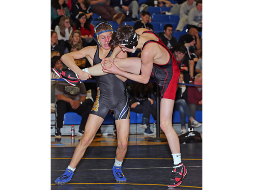 Mattituck's Jack Bokina (black and gold) defeated Connetquot's Danny Colondona (red and black) in the 113 Lbs finals of the North Fork Invitational which were held at Mattituck High School on Jan. 31, 2016.