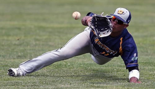 Nick Heath, the sole remaining player from North Fork's 2013 championship team, making a lunging catch of a fly ball hit by Sag Harbor's James Clements last Thursday. (Credit: Daniel De Mato)