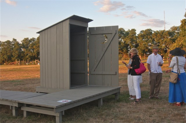 Guests at Hallockville Museum Farm during the opening reception Thursday evening of 'Outhouse 2014' by artist Michael Combs of New York City and Greenport. (Credit: Barbaraellen Koch)