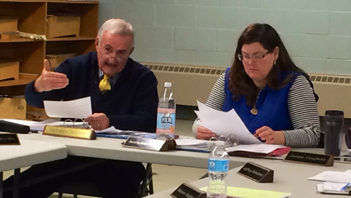 RACHEL YOUNG PHOTO | Oysterponds Superintendent Richard Malone, left, and school board president Dorothy-Dean Thomas, right, discuss the veterans tax exemption at Tuesday's school board meeting.