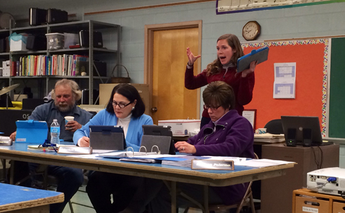 RACHEL YOUNG PHOTO | Oysterponds teacher assistant Brittany Knote, standing, gives a technology demonstration to school board members Tuesday evening.