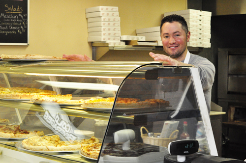 GIANNA VOLPE PHOTO  |  Joe Pagano, Jr. has seen plenty of familiar faces at the new Southold location for Pagano's Pizza.