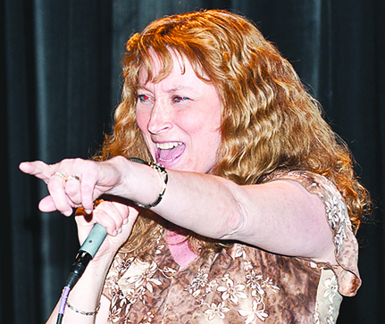 'Lady Di' sings Shania Twain's 'Any Man of Mine' for the second annual Sing East End karaoke benefit at Vail-Leavitt Music Hall on March 12. The event raised funds for East End Hospice.