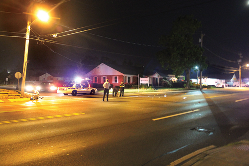 Police at the scene of the fatal hit and run on Route 58 near Woodcrest Avenue in July 2013. (Credit: Paul Squire, file)