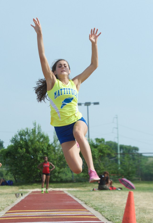 Alya Ayoub competes in the long jump.