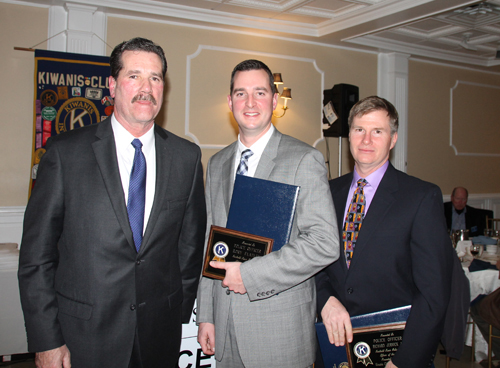 From left, Southold Town Police Chief Martin Flatley in January with this year's Officer of the Year award honorees Rory Flatley and Richard Jernick Jr. (Credit: Paul Squire, file)