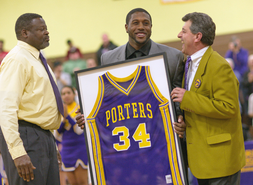 GARRET MEADE PHOTO  |  Ryan Creighton was presented a framed No. 34 Greenport jersey by varsity coach Al Edwards (left) and superintendent ichael Comanda Wednesday night.