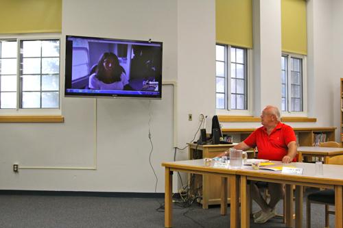 School board member Jeff Smith talking with Sarah Hassildine via Skype. (Credit: Jennifer Gustavson)