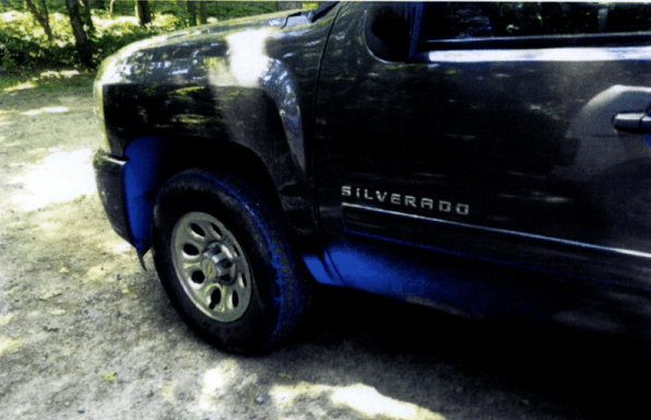 A photo filed to Southold Town shows the paint damage caused by a blue paint spill in Cutchogue last month. This damage — which also affected the back rims — cost the owner $ (Credit: William Smith)