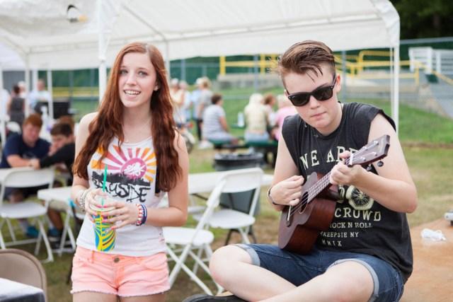 Cora Small of Southold sings while Keaton Comiskey accompanies on the ukulele.