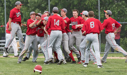 Southold players rushed onto the field after Liam Walker's two-out single brought in the winning run in the eighth inning. (Credit: Katharine Schroeder)