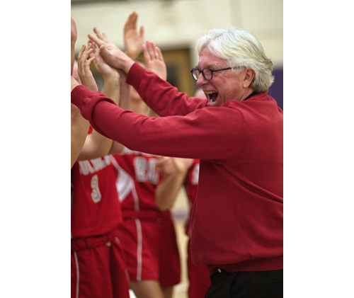 GARRET MEADE PHOTO | Southold's jubilant coach, Joe Read, celebrating with his players after they survived a semifinal scare in Port Jefferson.