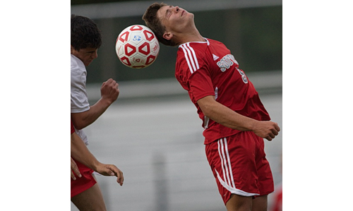Sean Moran, heading the ball, scored Southold's lone goal against Center Moriches on a penalty kick. (Credit: Garret Meade)
