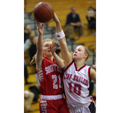Southold/Greenport's Justina Babcock, left, and Pierson/Bridgehampton's Kasey Gilbride both get a hand on the ball. (Garret Meade photo)