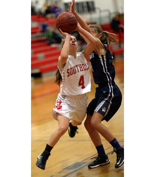 Southold/Greenport's Madison Tabor moves around Stony Brook's Anne Skorobohaty to attempt a layup. (Credit: Garret Meade)
