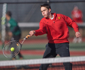GARRET MEADE PHOTO | One of Southold/Greenport's first doubles players, Drew Sacher, making contact during Friday's match at Longwood High School.