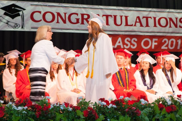 Judi Fouchet, vice president of the Board of Education, hands out one of dozens of awards and scholarships.