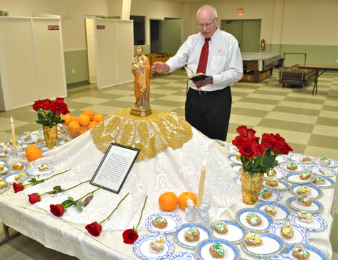 Deacon Jeff Sykes of Sacred Heart Parish blesses the traditional St. Joseph's table during the North Fork Italian-American Club's St. Joseph's Day celebration at the town recreation center in Peconic on Friday, March 25.