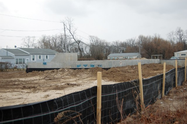 Earlier this year developer Nick Paleos of Nickart Realty Corp. in Baldwin said two homes going up along Route 48 near Town Beach in Southold would be finished by July. (Credit: Cyndi Murray, file)