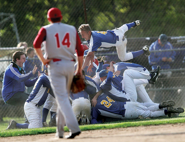 This photo of the Mattituck baseball team celebrating a come-from-behind win won in the sports feature photo category in the New York Press Association's Better Newspaper Contest. (Credit: Garret Meade, file)
