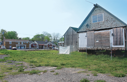 The former Galley Ho across the street from Legends and Summer Girl boutique on First Street's New Suffolk Waterfront Fund land. (Credit: Barbaraellen Koch)