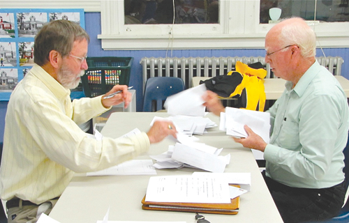 SUFFOLK TIMES FILE PHOTO | Former New Suffolk superintendent Bob Feger (left) and school board president Tony Dill last May.
