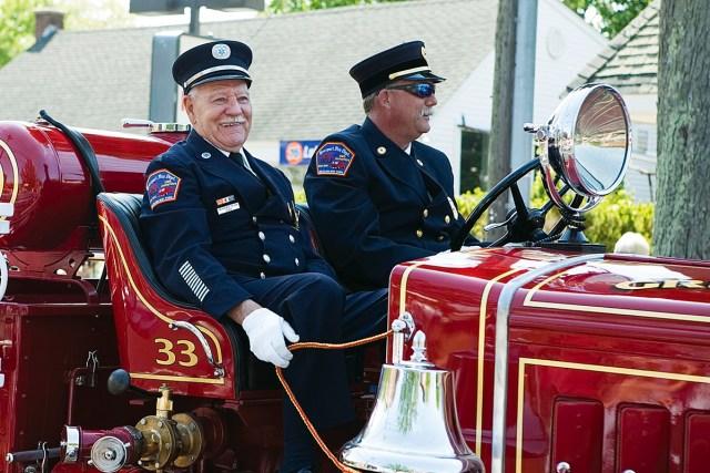George Capon (left) and John Grilli in the truck during the Southold Town Memorial Day parade last week. (Credit: Katharine Schroeder)