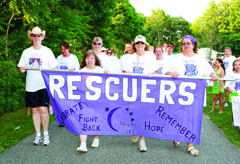 Greenport Rescue Squad members walk the track during last year's Southold Relay for Life.