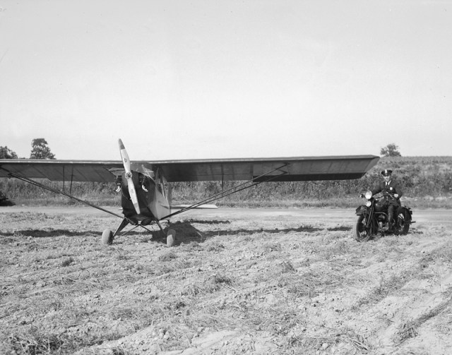 This 1930s photo shows police officer Pat Kelly with his motorcycle and private plane. Mr. Richter said Mr. Kelly would use the plane for police purposes when they needed an eye in the sky.
