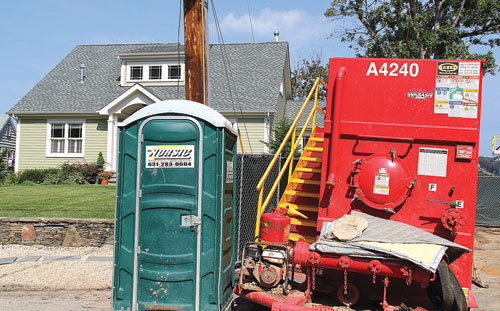 CARRIE MILLER FILE PHOTO | Equipment and a portable bathroom in front of the home of Robert and Celia Swing at the intersection of Island View Lane and Bay Shore Road.