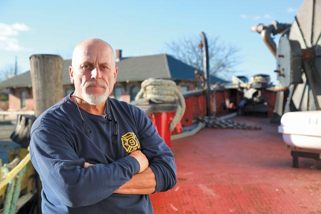 Charlie Ritchie, president of the Fireboat Fire Fighter Museum, aboard the fireboat in Greenport last week. (Credit: Krysten Massa)