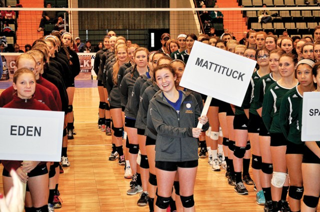 Meghan McKillop held Mattituck's sign as the Class C teams lined up during the opening ceremony at Glens Falls Civic Center. (Credit: Jim Ellis)