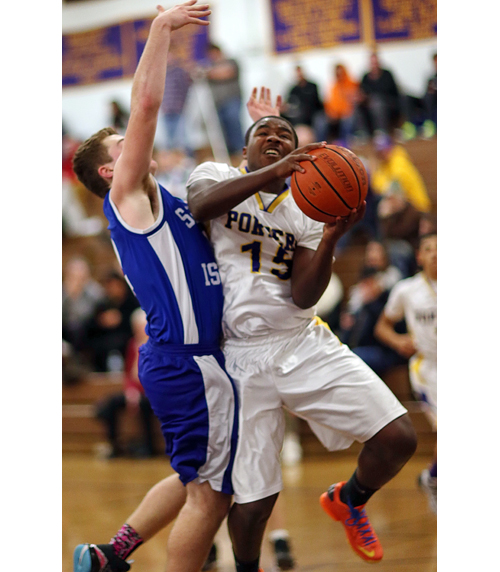 Tyshie Williams drives to the basket against Shelter Island Friday night. (Credit: Garret Meade)