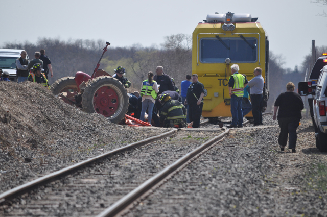 First responders on scene of the accident in Laurel Tuesday afternoon after a train collided with a tractor. (Credit: Grant Parpan)