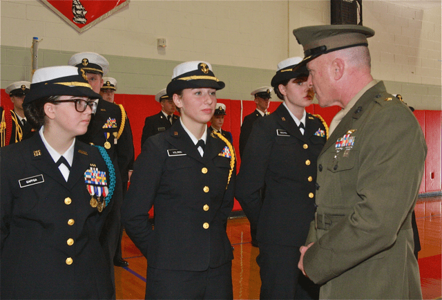Southold-Mattituck-Greenport Navy Junior Reserve Officer Training Corps senior instructor Major William Grigonis talks to some of the cadets after the inspection.