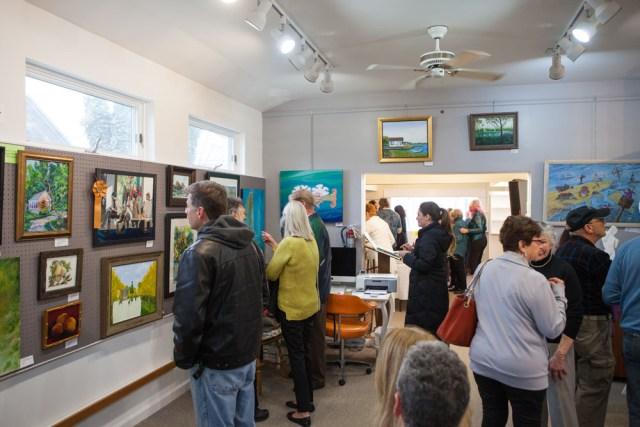 Visitors enjoying the beautiful artwork.