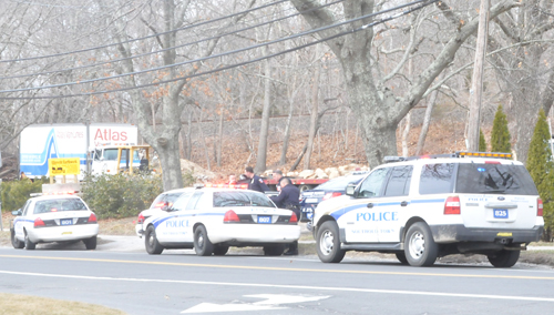 Southold Town police investigate a scene on Main Road in Laurel Friday morning. (Credit: Michael White)
