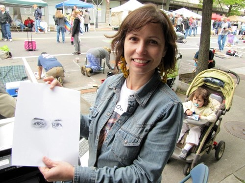 "Flanders artist Andrea Cote at last year's ""Eyes on Main Street"" event. (Credit: Tim Gannon)"