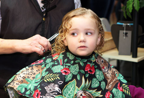 Bridget Mulrain, 3, of Mattituck prepares for the first snip of the Fourth Annual Hope for a Cure Cut-A-Thon on Southold Saturday.