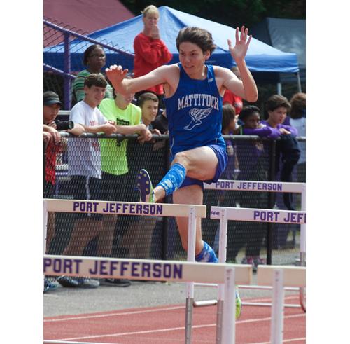 Mattituck junior Jack Dufton runs the 110-meter hurdles Friday in the pentathlon. (Credit: Robert O'Rourk)