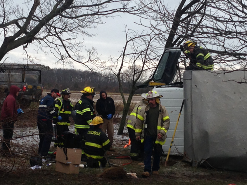 Cutchogue Fire department officials were called to the scene of an overturned vehicle on Route 48 Monday afternoon (Credit: Paul Squire)