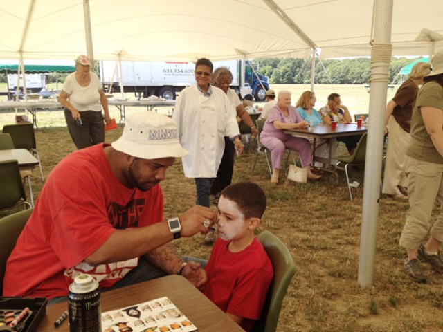 Face-painting was one of the ways kids got to enjoy the day's festivities in Mattituck Aug. 5. (Credit: Sonia Spar)