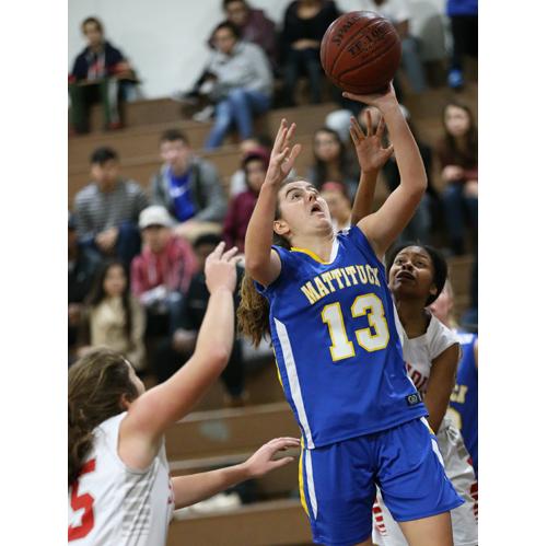 Liz Dwyer drives to the basket Thursday against Southold/Greenport. (Credit: Garret Meade)