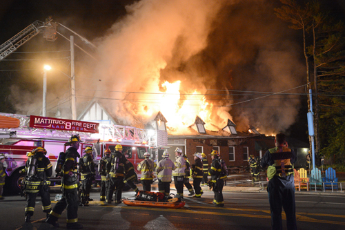 A massive fire destroyed several storefronts on Main Road in Mattituck Friday night and left one man dead. (Credit: Stringer News/A.J. Ryan)