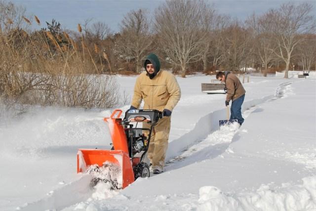 Craig Owens of Greenport and Michael Bredemeyer of Orient  tackle snowed in walkways so patrons could gain access to the park.