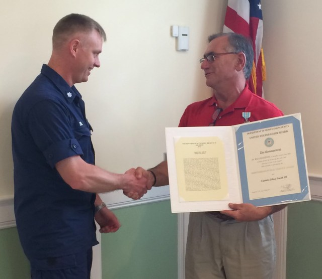 Cmdr. Jonathan Theel, of Sector Long Island Sound (left) presents the commendation to Greenport fishing captain Sid Smith. (Credit: courtesy)