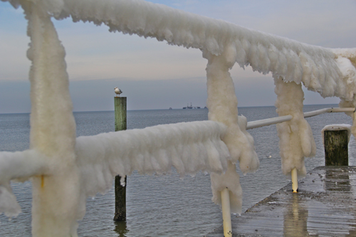 The ice covered rails at Iron Pier Beach in Northville are starting to melt. (Carrie Miller Photo)