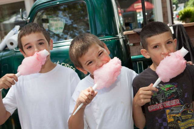 "Nothing says ""street fair"" like cotton candy.  From left:  Nick Dombroski, 9, brother Alex, 8, and friend Jayden Martino, 8, all of Ridge. (Credit: Katharine Schroeder)"