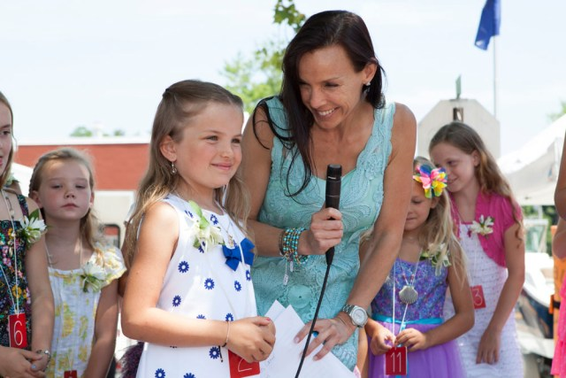 Host Danielle Cardinale congratulates winner Julie Bodenstein, 6, of Cutchogue. (Credit: Katharine Schroeder)