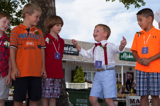 Ryan Harned, 6, of Cutchogue, reacts when he hears his name called as winner of the Little Mr. Mattituck contest. (Credit: Katharine Schroeder)
